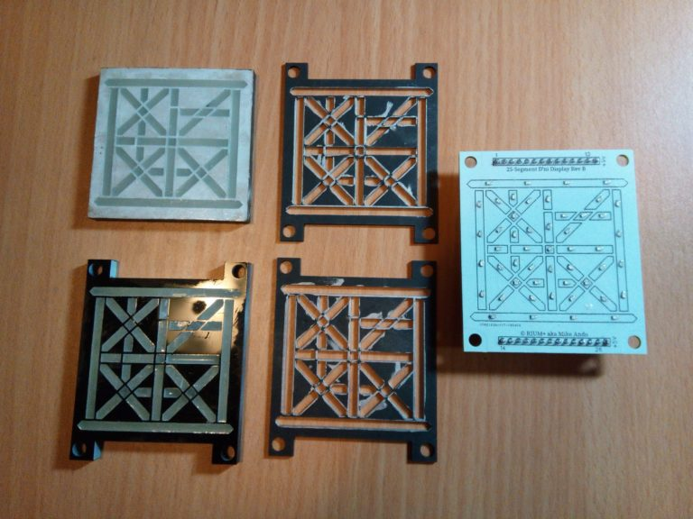 The 5 layers in the 25-segment digital D'ni display modules - acrylic layers on the left, cardboard gaskets in the middle, circuit board on the right